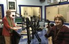 "As host of the ""Arts Talk"" radio show, Catherine Rickbone (left) talked with Teresa Simmons, vice chair of the Siletz Tribal Arts and Heritage Society, about the group and its dream for a new building. Photo courtesy: Oregon Coast Council for the Arts"