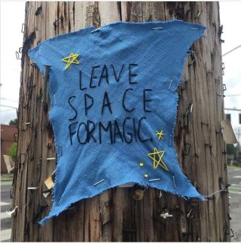 """embroidered message """"leave space for magic'"""