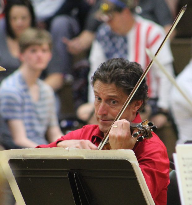 Peter Frajola, associate concertmaster with the Oregon Symphony, sits in on violin during the 2017 performance. Photo courtesy: Newport Symphony Orchestra