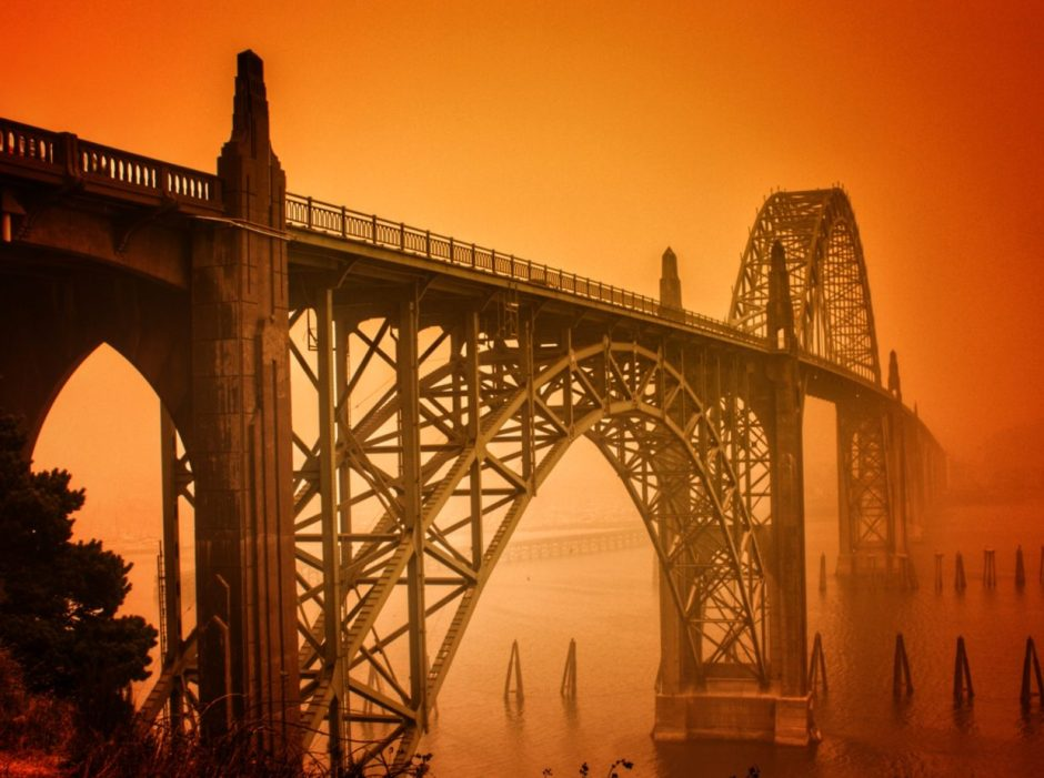 "Benjie King shot the Yaquina Bay Bridge in the smoky glow caused by wildfire. ""You won't see the sky like that again, hopefully, ever again,"" he says. Photo by: Benjie King, Out West Photography"
