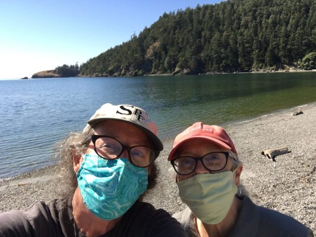 Artists Natalie Niblack (left) and Ann Chadwick Reid share environmental interests that include monthly monitoring of beach debris for the Coastal Observation and Seabird Survey Team Program (COASST), here at Bowman Bay in Washington's Deception Pass. Photo courtesy: Ann Chadwick Reid