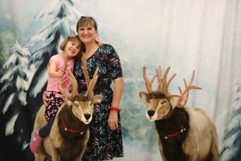 Volunteer Kayla Tyrrell and her daughter, Mikayden Stuart, visit the reindeer room during the 2019 tree-lighting party. Photo courtesy: Lincoln City Cultural Center