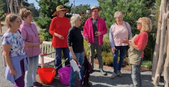 In pre-COVID days, Ketzel Levine (far right) leads a discussion in the Wonder Garden. She says the garden has become the No. 1 gathering place in Manzanita for people who wanted to get together in masks. Photo courtesy: Ketzel Levine