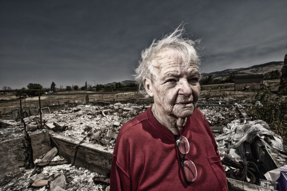 """Clackamas County photographer Bruce MacGregor's """"Aftermath Project"""" is documents the effects of 2020's wildfires. This is Edna on site of her burned home in Ashland."""