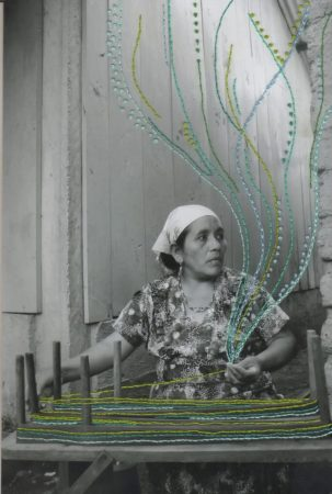 """Lucia Torres' work in a show at Linfield University """"connects the relationship between women, community, art, music, healing, identity, and cultural heritage."""""""
