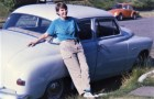 Cartoonist Theresa McCracken in 1987 with the 1951 Plymouth that took her back and forth between Washington, D.C. and Yachats. Three years later, she bought land in Waldport and started to build a home. Photo courtesy: Theresa McCracken