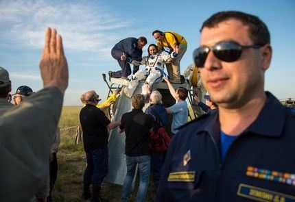 Expedition 43 cosmonaut Anton Shkaplerov of the Russian Federal Space Agency (Roscosmos) is helped out of the Soyuz TMA-15M spacecraft just minutes after he and NASA astronaut Terry Virts of NASA, and Italian astronaut Samantha Cristoforetti from European Space Agency (ESA) landed in a remote area near the town of Zhezkazgan, Kazakhstan on Thursday, June 11, 2015. Virts, Shkaplerov, and Cristoforetti are returning after more than six months onboard the International Space Station where they served as members of the Expedition 42 and 43 crews. Photo Credit: (NASA/Bill Ingalls)
