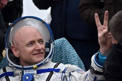 International Space Station (ISS) crew member Scott Kelly of the U.S. shows a victory sign after landing near the town of Dzhezkazgan, Kazakhstan, on March 2, 2016. US astronaut Scott Kelly and Russian cosmonaut Mikhail Kornienko returned to Earth on March 2 after spending almost a year in space in a ground-breaking experiment foreshadowing a potential manned mission to Mars. AFP PHOTO / POOL / KIRILL KUDRYAVTSEV