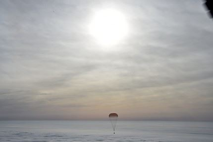 Russia's Soyuz TMA-18M space capsule carrying the International Space Station (ISS) crew of US astronaut Scott Kelly and Russian cosmonauts Mikhail Kornienko and Sergei Volkov lands in a remote area outside the town of Dzhezkazgan, Kazakhstan, on March 2, 2016. US astronaut Scott Kelly and Russian cosmonaut Mikhail Kornienko returned to Earth on March 2 after spending almost a year in space in a ground-breaking experiment foreshadowing a potential manned mission to Mars. AFP PHOTO / POOL / KIRILL KUDRYAVTSEV