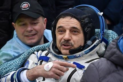 International Space Station (ISS) crew member Mikhail Kornienko of Russia reacts after landing near the town of Dzhezkazgan, Kazakhstan, on March 2, 2016. US astronaut Scott Kelly and Russian cosmonaut Mikhail Kornienko returned to Earth on March 2 after spending almost a year in space in a ground-breaking experiment foreshadowing a potential manned mission to Mars. AFP PHOTO / POOL / KIRILL KUDRYAVTSEV