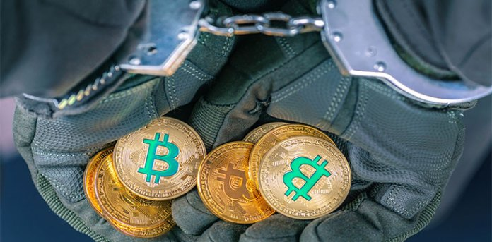 Bitcoin in handcuffed hands sweden