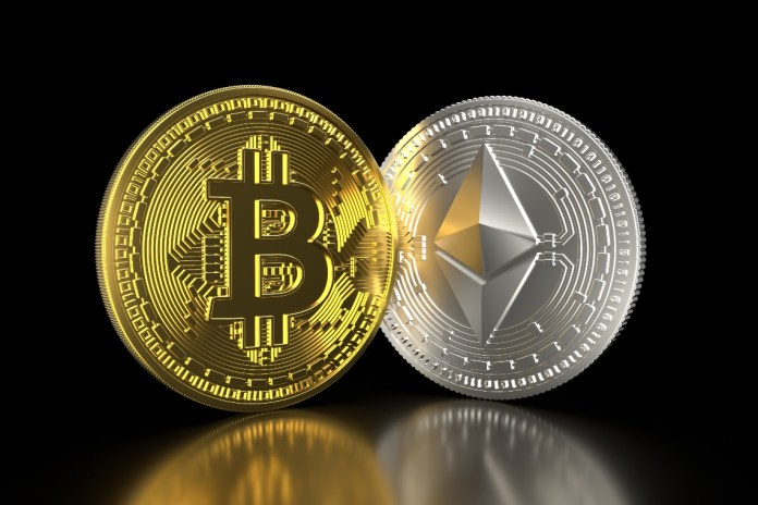 Picture of a gold bitcoin and a silver Ethereum standing next to each other