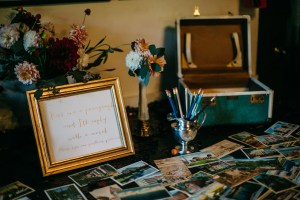 guest book table - vintage postcards & suitcase