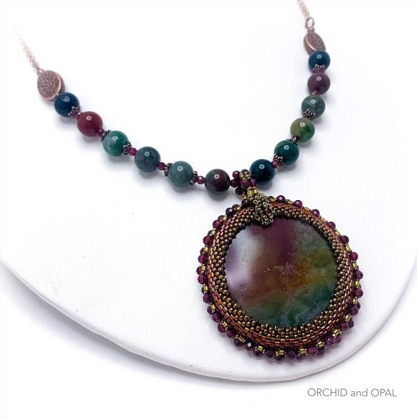 fancy jasper pendant necklace with garnet and beaded bezel