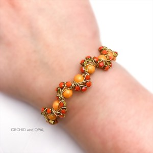 orange wavy memory wire cup chain beaded bracelet