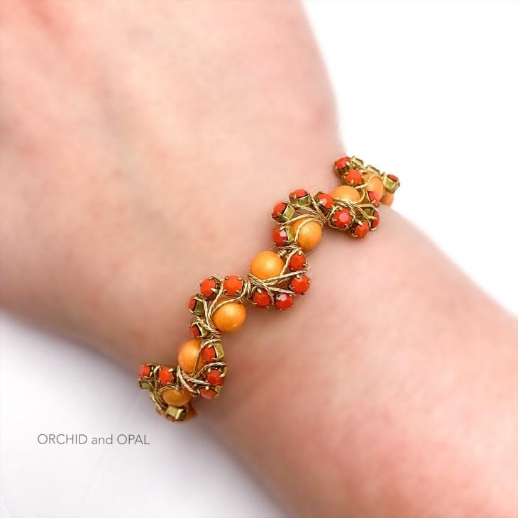 orange wavy memory wire cup chain beaded bracelet