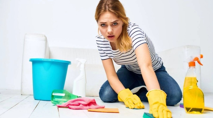 Woman cleaning floor on home Orchid Cleaning Services