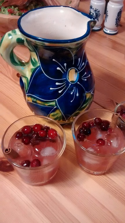 cranberry fireball cocktail in two glasses near a pitcher