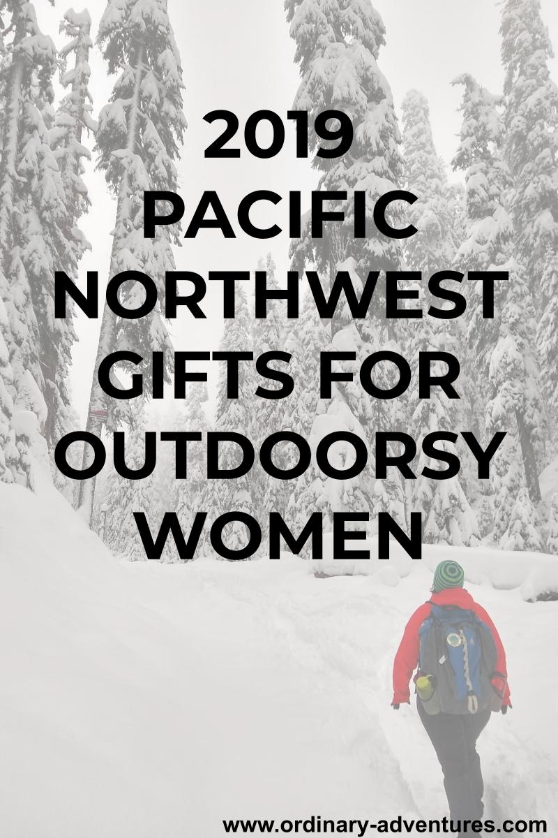 A person stands looking up at a snowy hill covered in snow covered evergreen trees. The person is wearing a red coat, black pants and a blue backpack and is facing away from the camera. Text reads: 2019 Pacific Northwest gifts for outdoorsy women