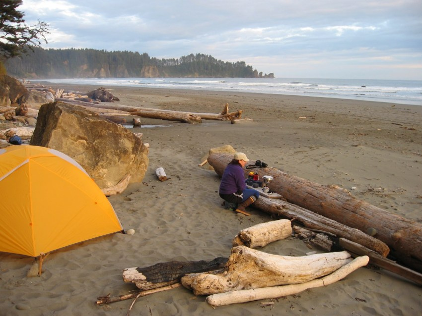 Olympic Coast backpacking means finding a spot on the beach to make your camp, set up the tent and find some logs to use as a camp kitchen