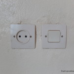 Moroccan outlet with light switch.