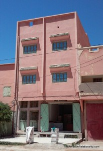Outside view of our building. Ours is the top floor. Below is a cooperative that sells honey straight from local hives.