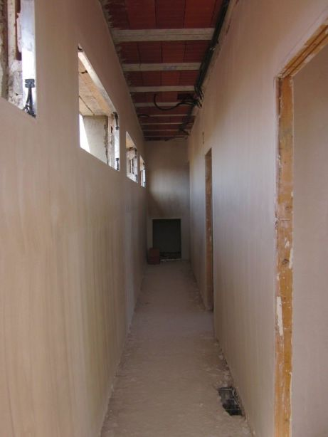The guest corridor plastered