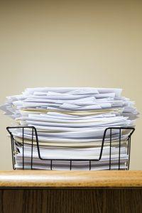 overflowing paper inbox