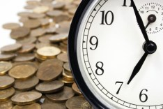 http://www.dreamstime.com/stock-image-time-money-concept-alarm-clock-against-coins-image40495091