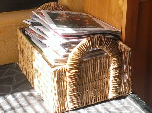 Magazine and catalog basket threatening to overflow. Don't let it! Purge now!