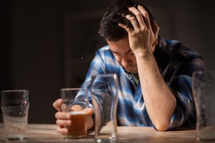 man drinking from depression