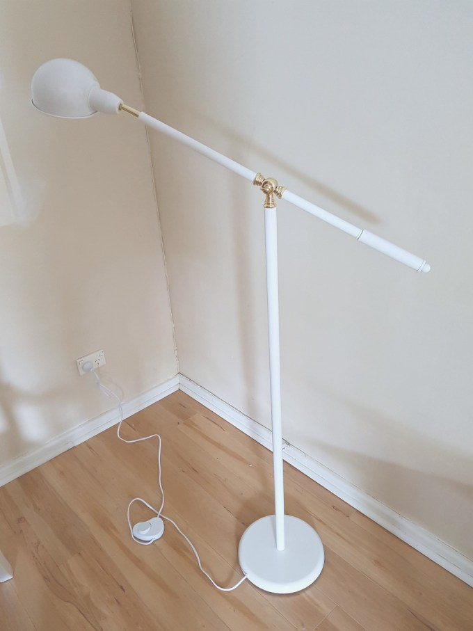 DIY reading nook the light source a white floor lamp
