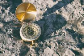 resized gold colored compass on stone aaron burden 261332 unsplash - Skillful means
