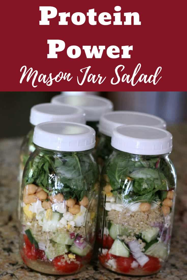 Mason jar salad recipe. Protein-packed ingredients chickpeas, quinoa, and eggs.