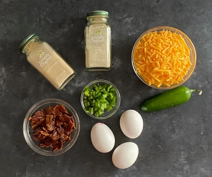 Ingredients for jalapeno cheddar egg bites - eggs, spices, bacon, cheddar, jalapeno