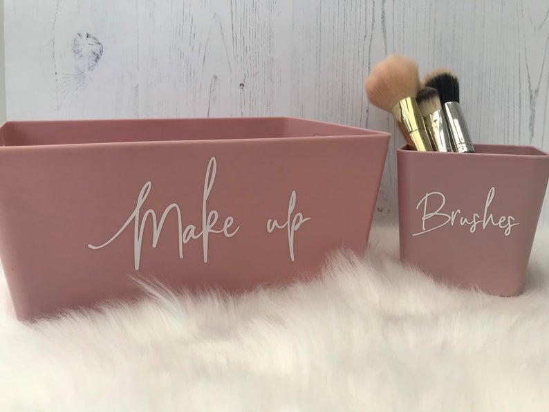 Two pink bathroom vanity organizers