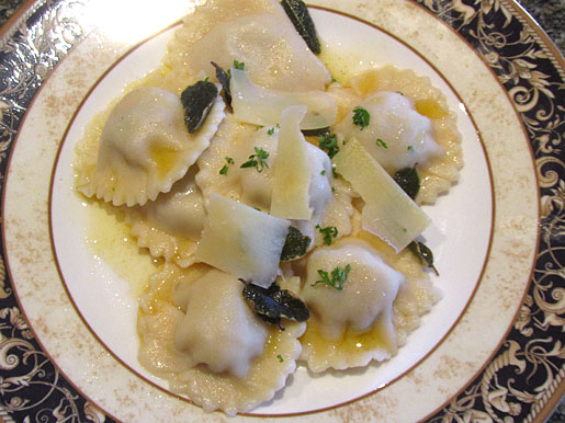 pumpkin ravioli with pine nuts with burnt sage butter