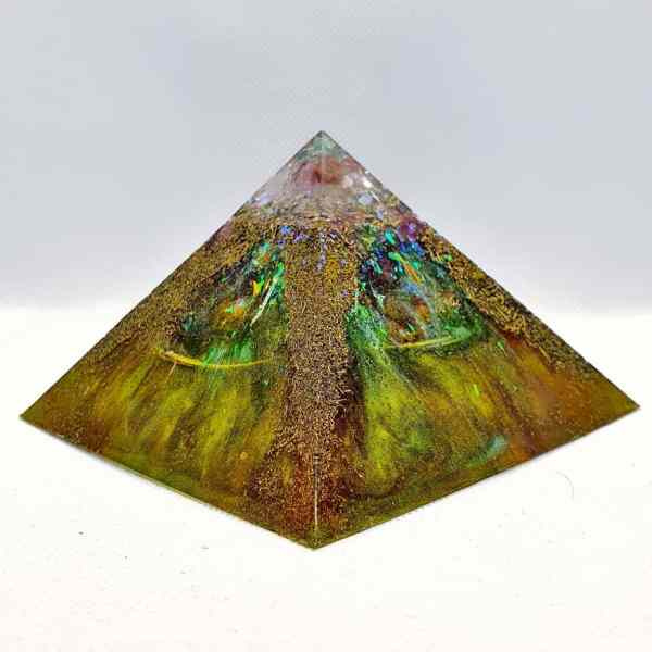 A rainbow colour Orgonite with Brass and Rainbow effect, in the shape of the Giza pyramids in Egypt