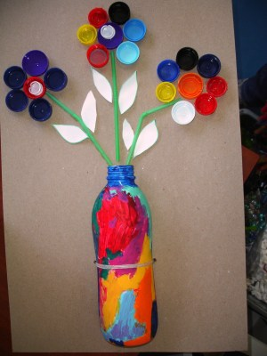 RECICLAMOS  TAPONES Y BOTELLAS