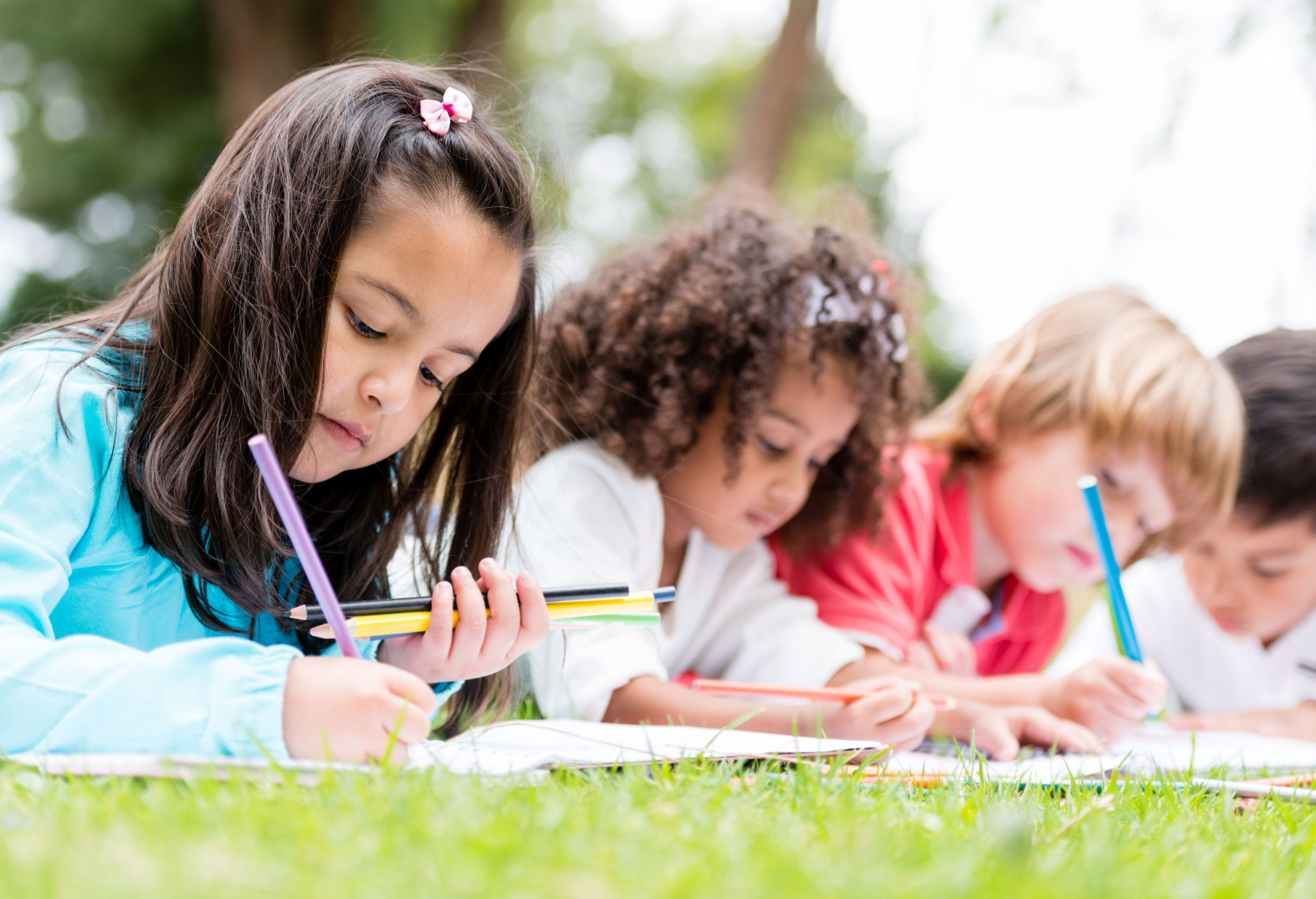 21788266 - happy group of children coloring at the park
