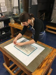 Ioana helps with placement and cleanup of the text block. This was a one-chance-only moment, once placed on the wet medium it cannot be moved or changed.