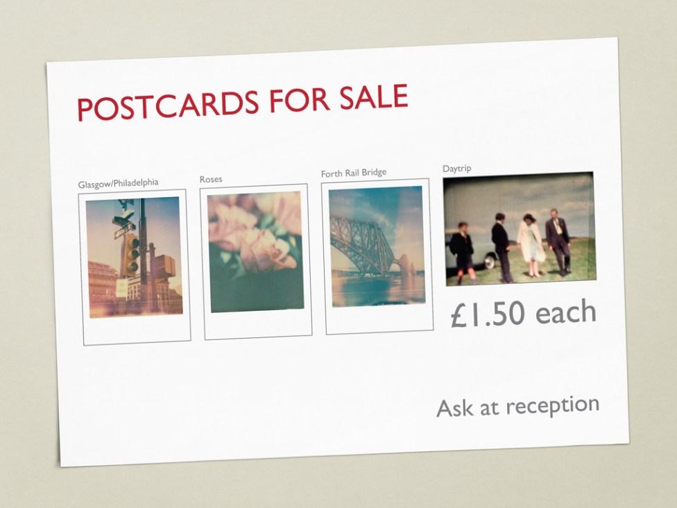 Signage for the sale of postcards, illustrating several designs