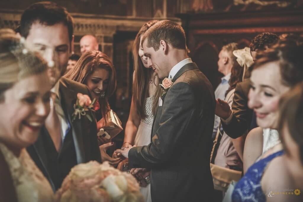 guests congratulate the groom