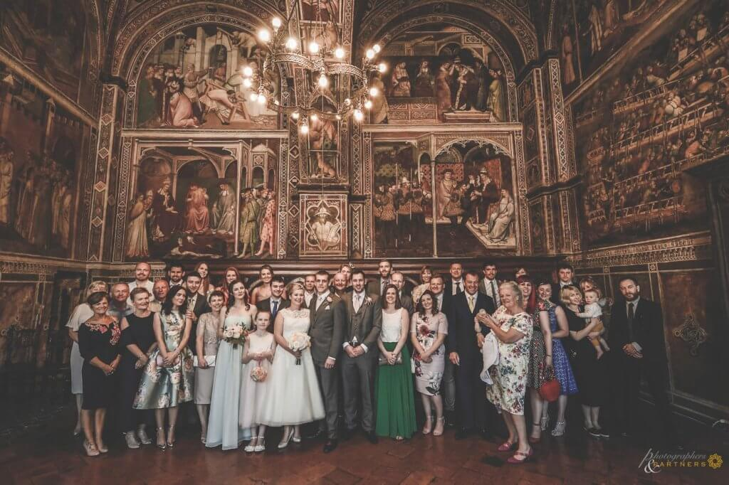 Bride and groom make a photo with guests