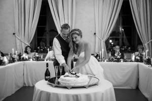 Whitney & Micheal cut the wedding cake