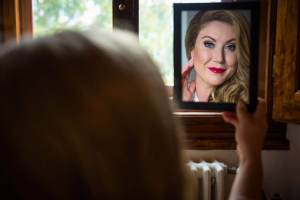 Bride look herself through the mirror