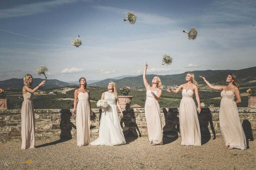 Emma and and bridesmaids throw the bridal bouquet.