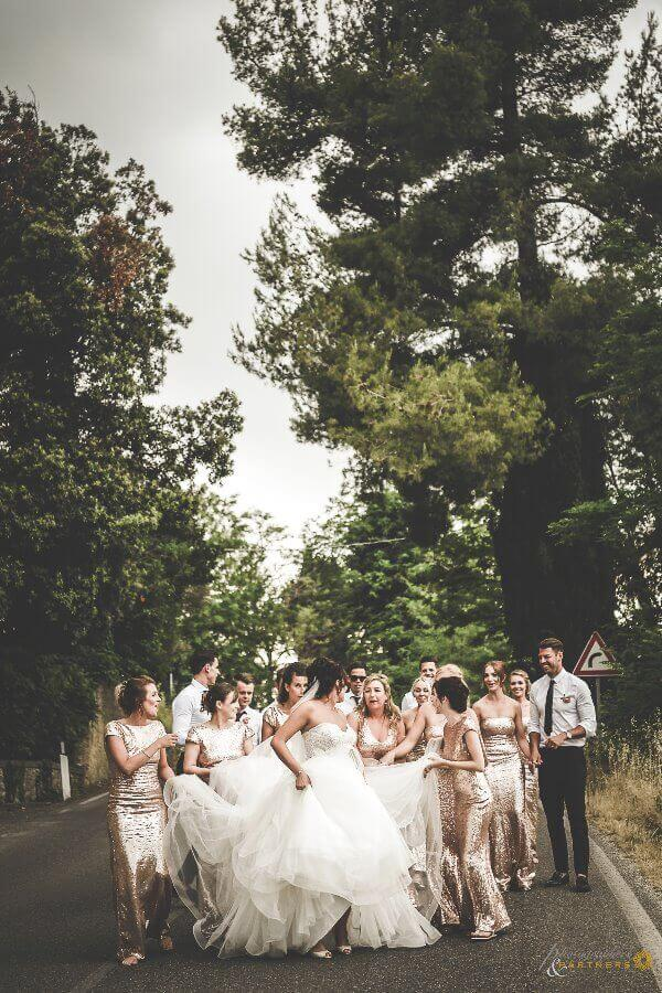 Bride walk with bridesmaids and groomsmen after the ceremony