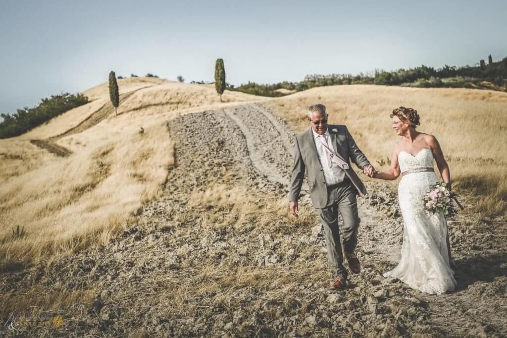 Carol & William walk through the tuscany country