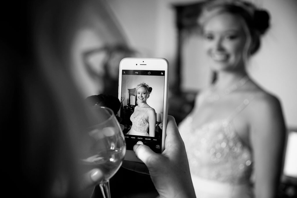 the bride's sister snaps a photo to the bride